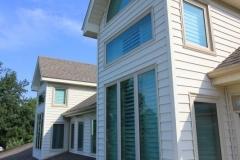 Aluminum Windows on white and brown house Pensacola FL